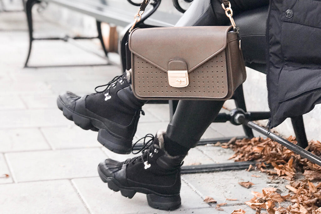 woman wearing funky boots and bag